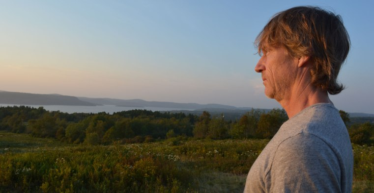 Artist's husband gazing at vast view of the river valley.