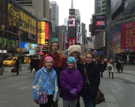 Artist in Times Square with her four children.