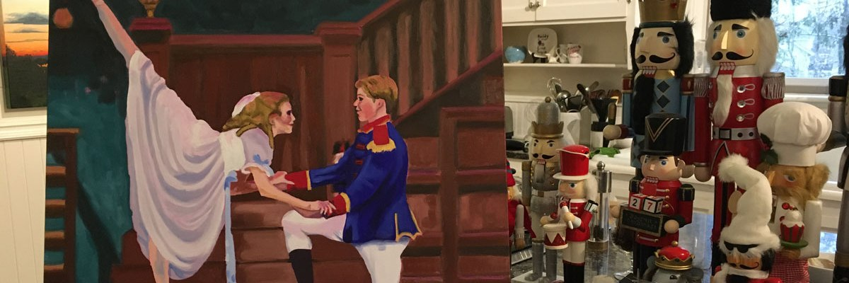 Painting of Clara and the Nutcracker stands alongside collection of Nutcrackers.