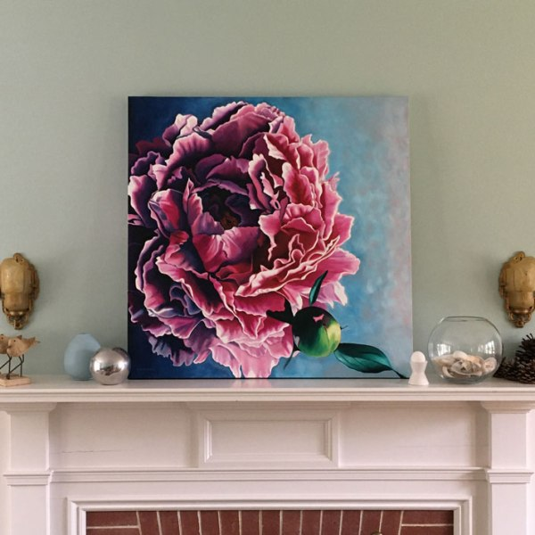 Painting of pink peony sits on mantle.